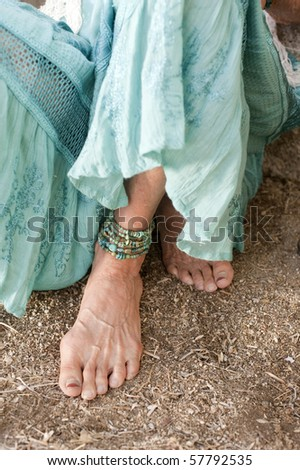 Podiatry Portrait of a lovely and graceful senior woman's foot. - stock photo