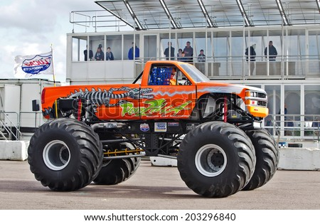 PODINGTON, UK - FEBRUARY 22: The resident Santa Pod Raceway monster truck, Podzilla, warms up before giving a display to the public at the Stuntfest show on February 22, 2014 in Podington - stock photo