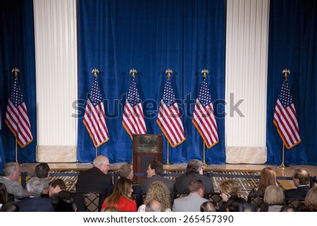 Podium and US Flags at the Trump International Hotel in Las Vegas, where Donald Trump would endorse Presidential Candidate Mitt Romney for President, February 2, 2012  - stock photo