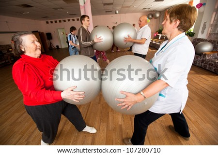 PODPOROZHYE, RUSSIA - JULY 5: Day of Health in Center of social services for pensioners and disabled Otrada (gymnastics with ball for eldery and disabled), July 5, 2012 in Podporozhye, Russia. - stock photo