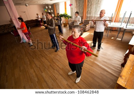 PODPOROZHYE, RUSSIA - JULY 5: Day of Health in Center of social services for pensioners and the disabled Otrada (gymnastics with sticks for eldery and disabled), July 5, 2012 in Podporozhye, Russia. - stock photo