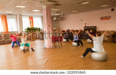 PODPOROZHYE, RUSSIA - MAY 3: Day of Health in Center of social services for pensioners and the disabled Otrada (gymnastics with ball for eldery), May 3, 2012 in Podporozhye, Russia. - stock photo