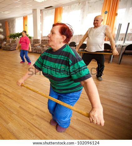 PODPOROZHYE, RUSSIA - MAY 3: Day of Health in Center of social services for pensioners and the disabled Otrada (gymnastics with sticks for eldery), May 3, 2012 in Podporozhye, Russia. - stock photo