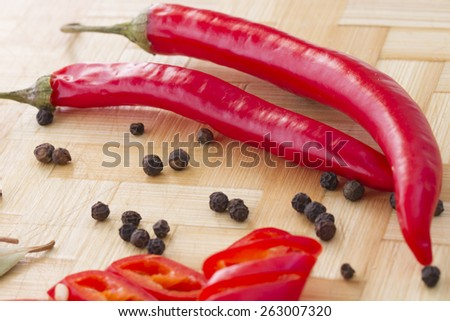 Pods of red hot pepper, peas allspice and bay leaf - stock photo