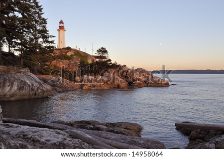 point atkinson lighthouse at sunset and moonrise