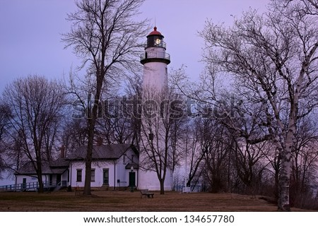 Point Aux Barques Lighthouse beacon alerting ships to the perils that lie beneath. Lighthouse County Park. Port Hope, Michigan. - stock photo
