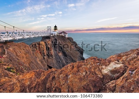 Point Bonita Lighthouse outside San Francisco, California stands at the end of a beautiful suspension bridge. - stock photo