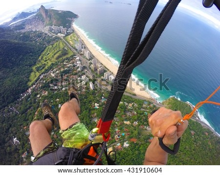 Point of view from paragliding pilot - stock photo