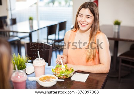 Point of view of a woman having lunch with a girlfriend and having a good time - stock photo