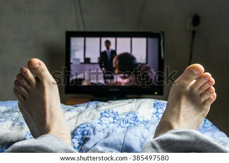 Point of view TV watching. Man watch movie. - stock photo