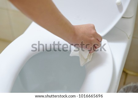 Point Of View Woman Hand Clean The Toilet Seat By Using Tissue Paper One