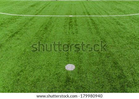 point on soccer field green grass - stock photo