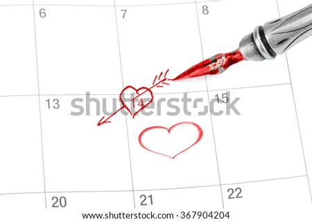 Point out Valentine's day in the calendar isolated on white - stock photo