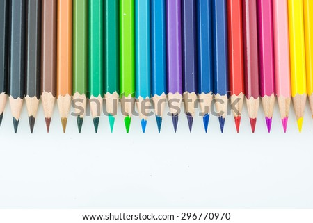 pointed color pencils and a white background