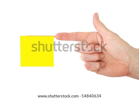 Pointed finger with a blank yellow office note - stock photo