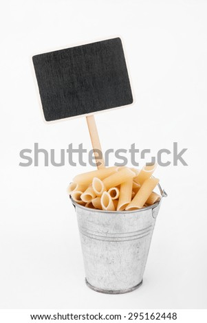 Pointer, price in bucket of  pasta, on a white background