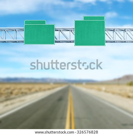 Pointer tracks, green road signs  - stock photo