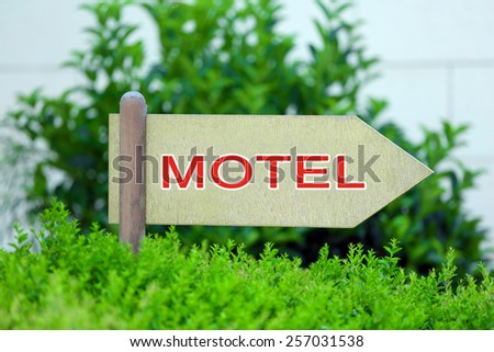 Pointer with text Motel - stock photo