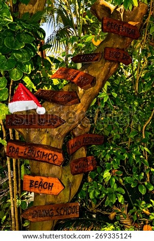 Pointers to the location of objects in the tropical hotel on island Ranveli, Maldives - stock photo