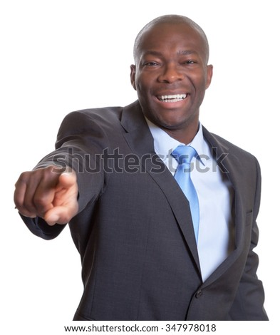 Pointing african businessman in a dark suit - stock photo