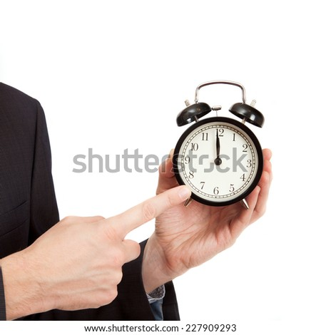 pointing finger on a clock - indicates a deadline hour