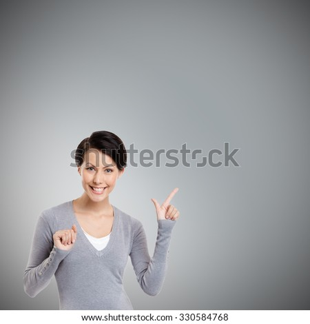 Pointing finger up, isolated on grey - stock photo