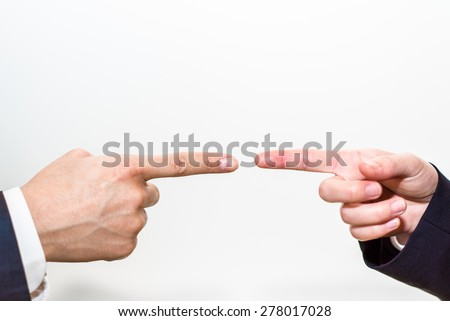 Pointing fingers at each other - stock photo