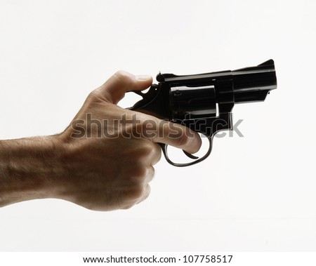Pointing gun on white background,holding little gun on white background.