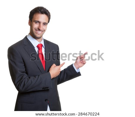 Pointing hispanic businessman with suit - stock photo