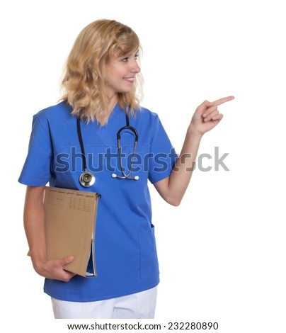 Pointing nurse with blond hair and file - stock photo
