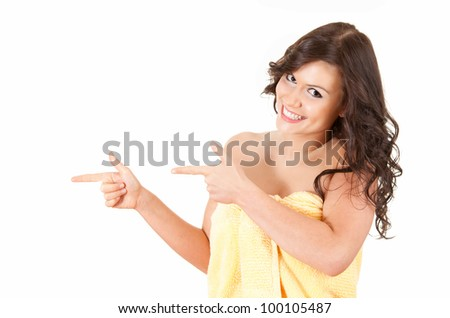 pointing teenage girl in towel, white background