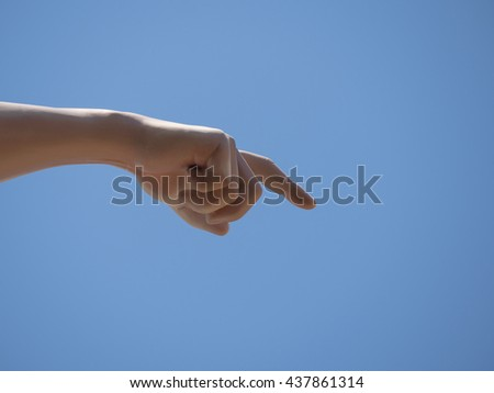 Pointing the way to the hands of the statue. Clear blue sky background