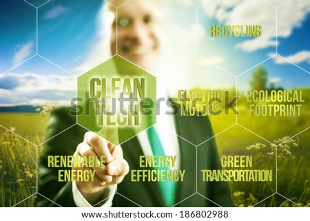 Pointing towards camera and pressing virtual screen button clean technology business concept - stock photo