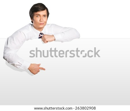 Pointing. Write your ideas here - Businessman pointing to blank space - stock photo