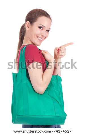 pointing young woman with green ecological shopping bag - stock photo