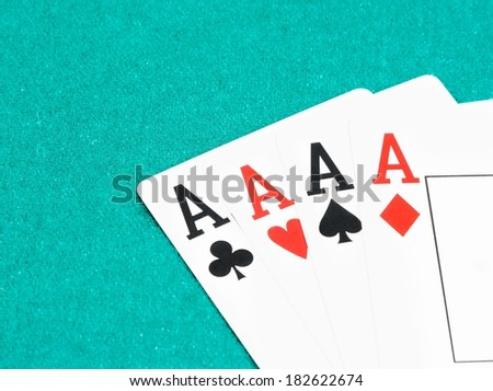poker aces cards on green table, concept of poker game with space for text - stock photo
