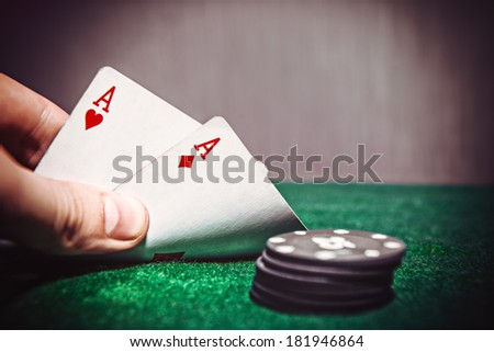 Poker Aces pair on the play table - stock photo