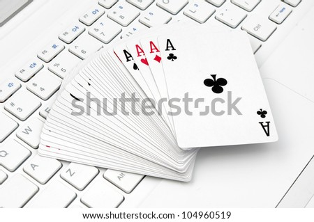 Poker and the computer keyboard (the expression of an online poker game or against the concept of online gambling)