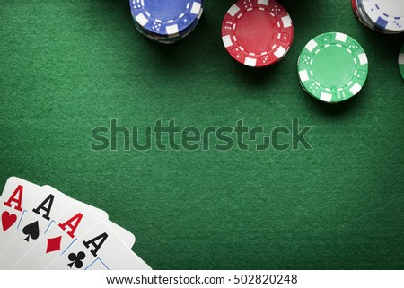 Poker background - chips and cards on green table
