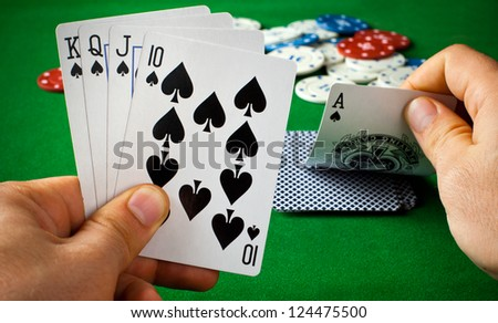 Poker cards on green table - stock photo