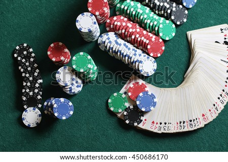 Poker chips and cards on the cloth - stock photo