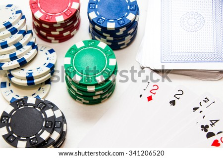 poker chips and cards, studio shot close up  - stock photo