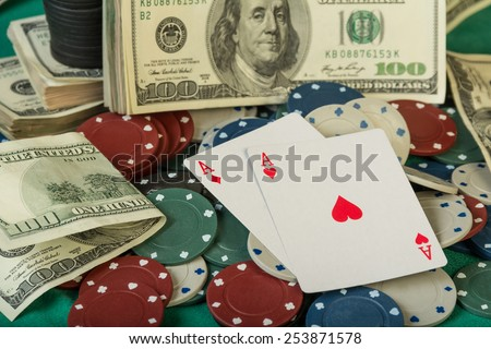Poker chips and dollar bills background - stock photo