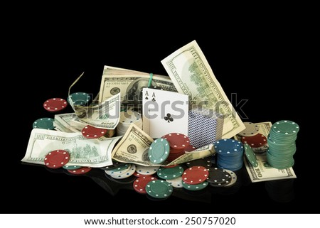 Poker chips and dollar bills on black background - stock photo
