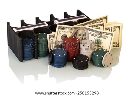 Poker chips and dollar bills on white background - stock photo