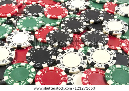 Poker chips background with red, black, green, white chips
