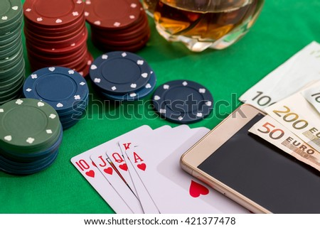 Poker chips, cards  and euro bills with cognac glass