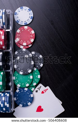 Poker chips for casino game on the table.