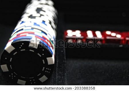 Poker chips in velvet tray - stock photo