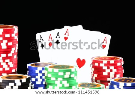 Poker chips isolated on a black background. - stock photo